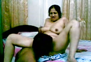 Pound Pal of a mature Desi woman gobbles her vag And pumps On the Couch