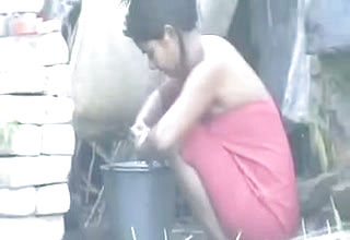 Indian neighbor lady washes outdoors as I film her on Spy webcam
