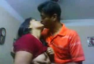 Lubricious Indian nymphomaniac lets Her paramour Caress her Well-matured udders
